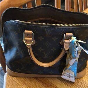 Like new LV authentic alma hand bag